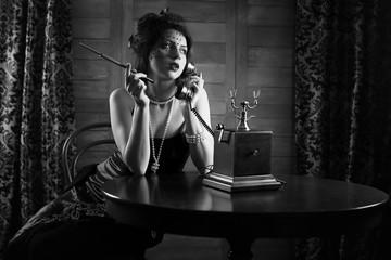 Beautiful 1930s girl smokes monochrome
