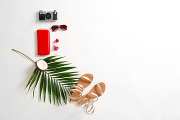 Flat lay composition with female items and photo camera on white background