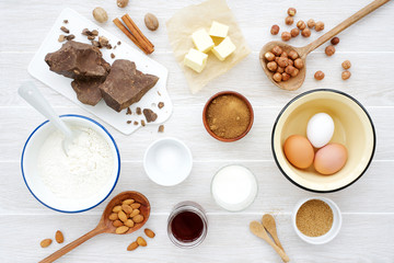 Ingredients for making chocolate baking on white wooden background