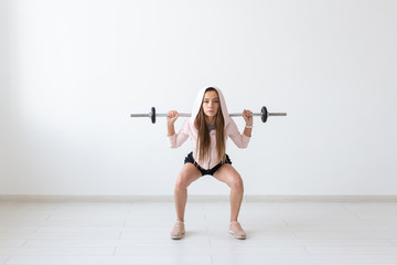 Healthy lifestyle, people and sport concept - Young and fit woman workout with weight