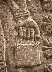 Assyrian wall relief of winged genius, detail with a hand