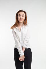 Portrait of beautiful brunette shy asian girl on white background