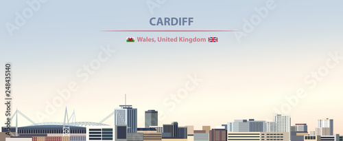 Fototapete Vector illustration of Cardiff city skyline on colorful gradient beautiful day sky background with flags of  Wales and United kingdom