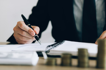 Investors are writing investment records and growth of mutual funds on the table at the office.