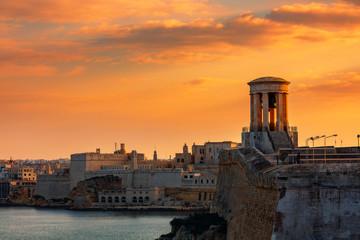 Siege Bell War Memorial and old fortress in Valletta, Malta.