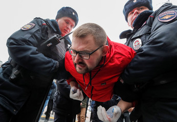 Police officers detain a protester during a rally to demand freedom for political prisoners in Moscow