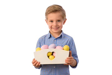 Easter and child. Boy and colorful Easter eggs in a small basket, yellow newborn chicken. White background.