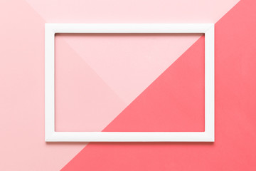 Abstract geometrical living coral and pastel pink paper flat lay background. Minimalism, geometry and symmetry template with empty picture frame mock up.