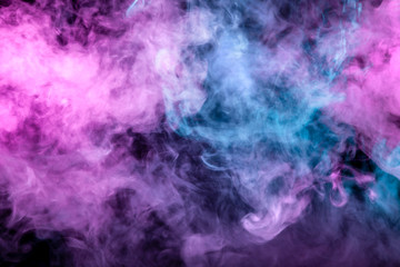 Beautiful pattern of smoke on a black background from the evaporating waves in the neon light of pink blue and purple as sea pebbles in the foam for T-shirt.