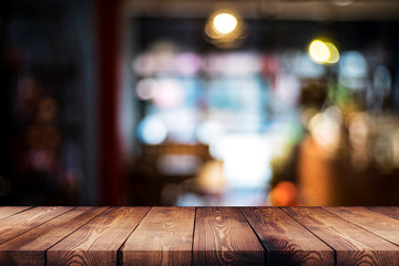 wood table on blur cafe, coffee shop, bar, background - can used for display or montage your products