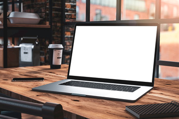 Laptop blank screen in loft interior office building