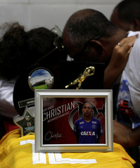 Relatives and friends of goalkeeper Christian Esmerio, 15, react during his funeral after a deadly fire at Flamengo soccer club's training center, in Rio de Janeiro