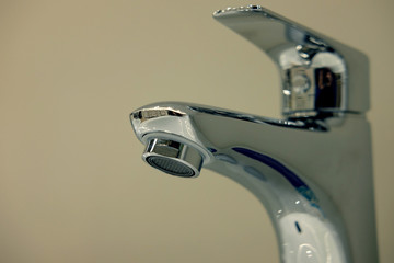 Modern bathroom faucet close up picture