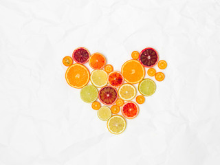 heart shaped with different slices of healthy fruits