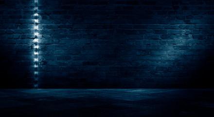 Old brick wall, dark room with brick wall, rays of searchlight light, illuminated night lights on an empty wall. Dark street, night city. Fotomurales
