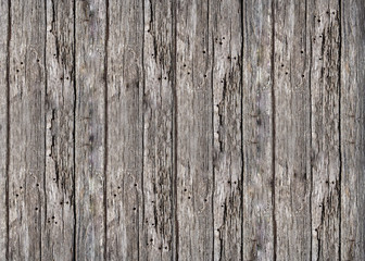 Old grey vertical wooden boards texture background .