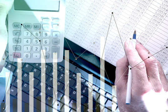 Pointing at spreadsheet on laptop with calculator and bar chart