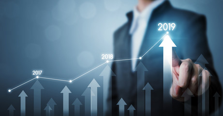 Business development to success and growing growth year 2019 concept, Businessman pointing line dot graph and arrow corporate future growth plan Fotomurales