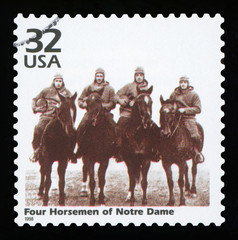 UNITED STATES OF AMERICA - CIRCA 1998: a postage stamp printed in USA showing an image of four players of Notre Dame Fighting Irish football team, circa 1998.