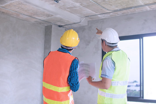 engineer inspector checking and introduce construction in building