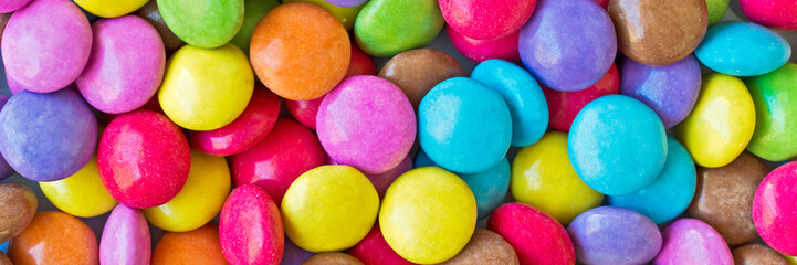 Colorful round candies panoramic background
