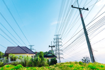 Background of electricity pole system with home, Power electricity distribution line to rural countryside, Concept of energy conservative, Electricity pylon with copy space to use as background Wall mural