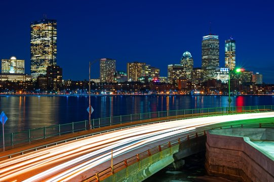 Long exposure of Boston skyline at night with charles river and memorial drive