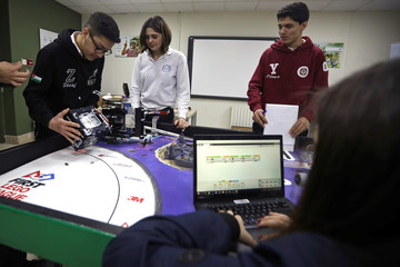 Students work on programming and developing their robots to work in a virtual space station at Jubilee School in Amman