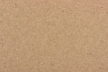 texture of beige cardboard, plywood of uniform structure and lighting.