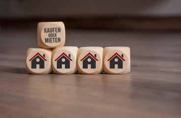 Würfel mit Haus Icon und Kaufen oder Mieten
