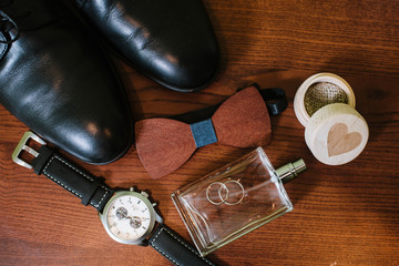 Grooms accessories for preparation on wedding day, shoes, rings and bouquet