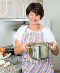 mature woman kitchen soup
