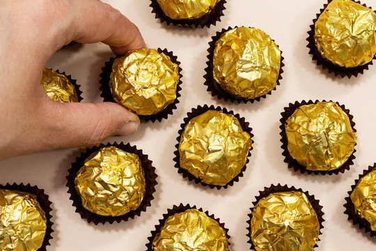 woman eat a golden premium chocolate sweets