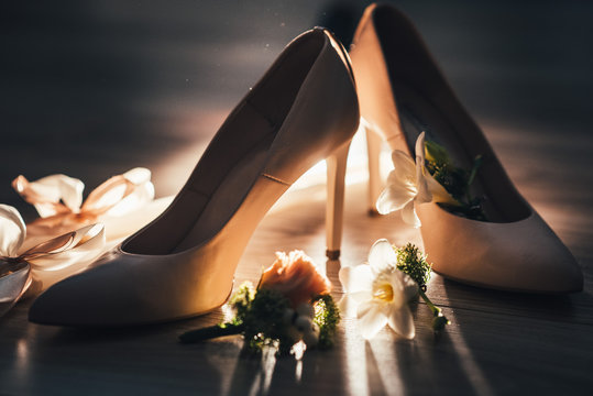 Brides accessories pretarations for wedding day, shoes and buttohole