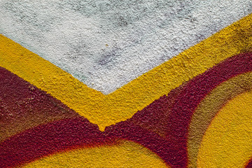Graffiti painted on a concrete wall texture.
