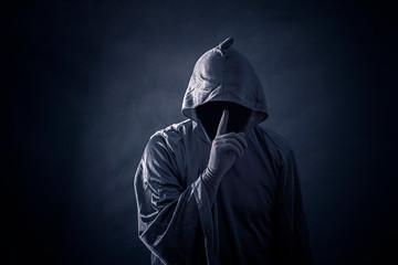 Scary figure in hooded cloak Wall mural