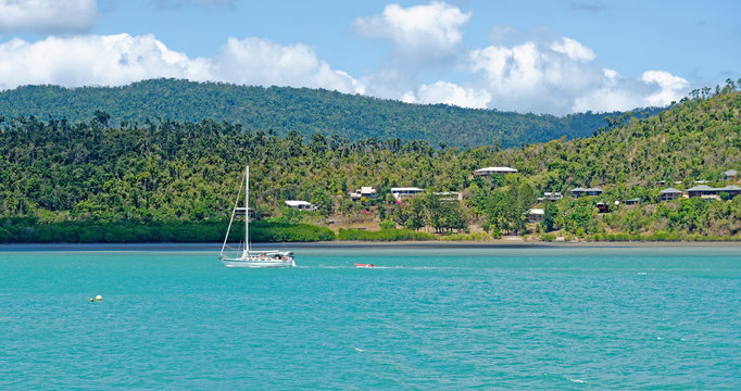 Sailboat under power offshore from Airlie Beach in tropical, Queensland, Australia