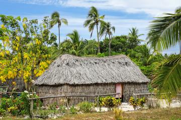 Traditional Kanak house on Ouvea Island,  Loyalty Islands, New Caledonia