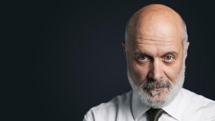 Black and white portrait of a confident mature businessman