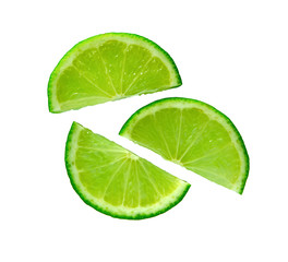 Lime. Juicy slice of lime. Lime slice isolated. Ripe green lime