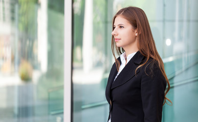 Portrait of a beautiful business woman in front of her office