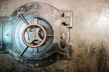 Bank safe (strongbox) old lock with wheel on the matal door