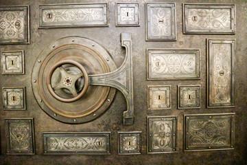 Bank safe (strongbox) vintage lock with wheel on the metal door
