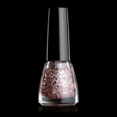 Nail polish with sparkles on a black background. Isolation