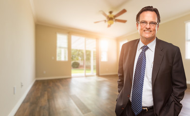 Handsome Male Wearing Suit and Tie In Empty Room of House