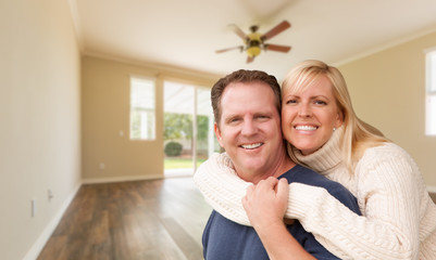 Happy Caucasian Young Adult Couple In Empty Room of House