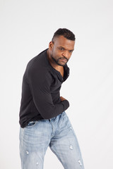 Thoughtful Black man in a black shirt and jeans