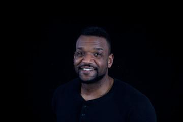 Smiling Black man in black shirt