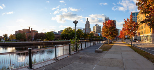 Providence, Rhode Island, United States - October 25, 2018: Panoramic view of a beautiful modern downtown city during a vibrant sunny sunset.