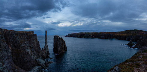 Beautiful panoramic seascape of a rocky Atlantic Ocean Coast during a cloudy sunset. Taken in Spillars Cove, Bonavista, Newfoundland and Labrador, Canada.